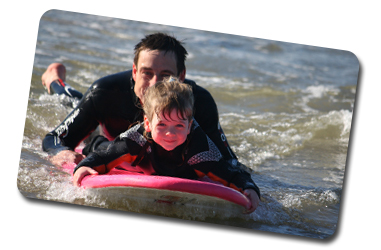 Children surf lesson in Wales with Board Games Surfing
