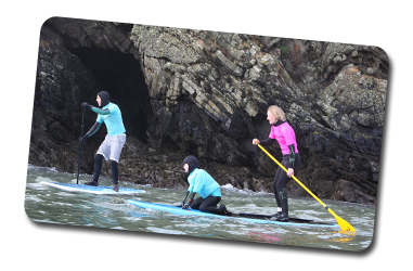 Family on a Stand up Paddle Boarding adventure in Pembrokeshire, West Wales