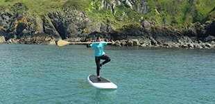 Stand Up Paddleboarding adventures and lessons out of Fishguard harbour. Paddle along the North Pembrokeshire Coast, West Wales