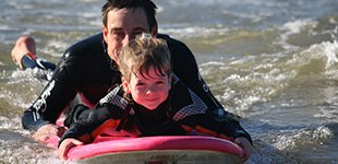 Children Surf lesson at Newgale Beach in Pembrokeshire, West Wales