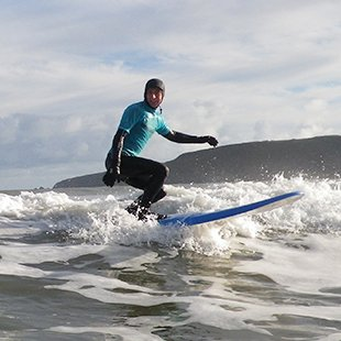Adults Surfing lesson at Newgale beach near St Davids in Pembrokeshire, West Wales