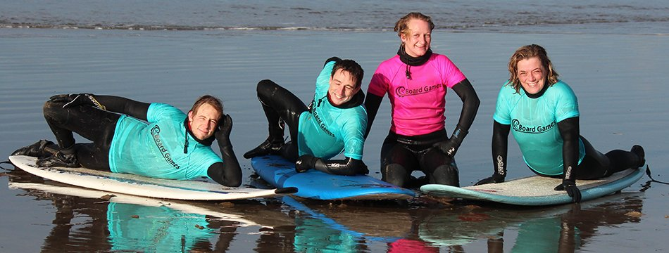 Surfing lesson at Newgale Beach, Pembrokeshire, West Wales with Board Games Surfing Ltd. Adults and children, beginners and intermediate surfers welcome. All equipment supplied including surfboard or bodyboard, paddleboard, paddle, wetsuit, boots, hood and gloves.