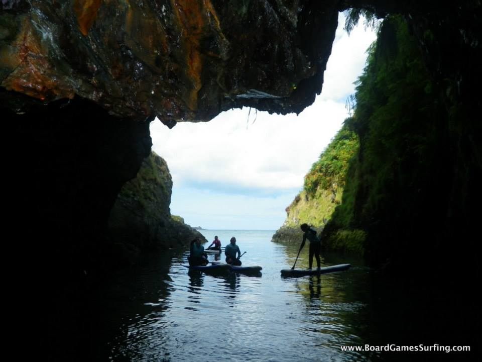 Exploring Caves while stand up paddleboarding in pembrokeshire wales