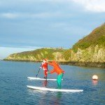 Father Christmas & Elf Paddleboarding