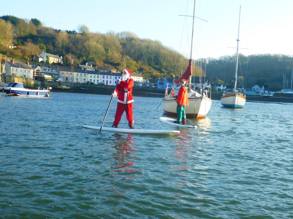 Learning Paddle Boarding basics in Fishguard Lower Town Harbour...