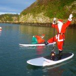 Father Christmas Paddle Boarding