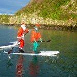 Santa & Elf Paddleboarding