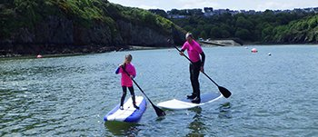 Family Stand Up Paddleboarding adventures in Pembrokeshire Wales. Starting out in Fishguard Lower Town harbour, once you've got your balance, head out along the coast.