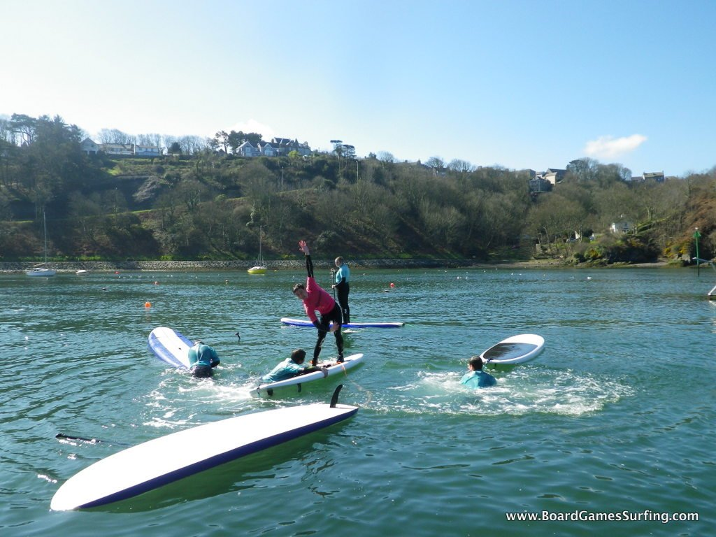 Stand up Paddle Boarding pirates, Lower Town Harbour Fishguard Pembrokeshire