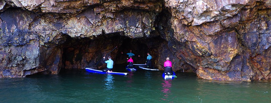 Exploring sea caves while paddleboarding in North Pembrokeshire