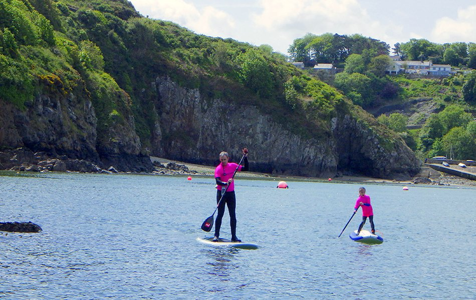 Families paddleboardin in Pembrokeshire