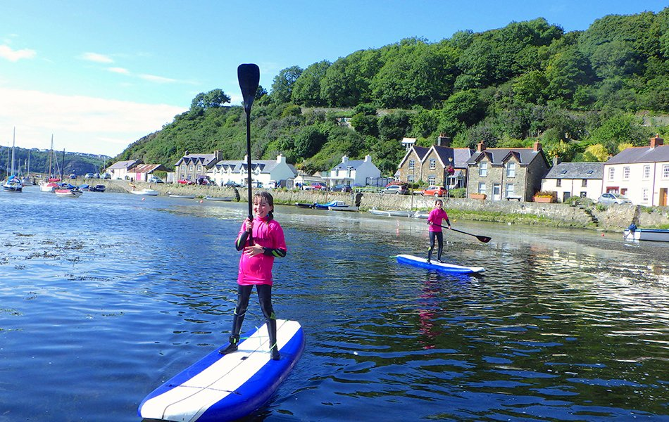 Children Paddle Boarding in Fishguard Harbour