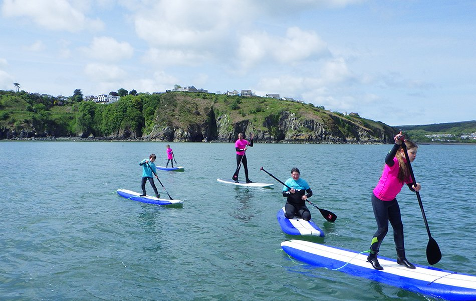 Family day out paddle boarding Wales
