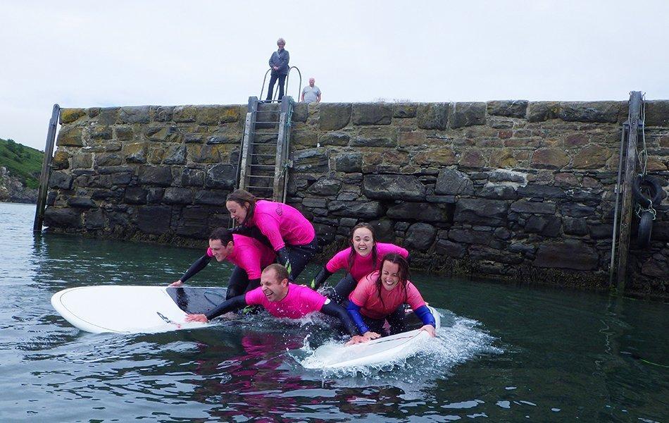 Adult paddleboarding pyramid fail