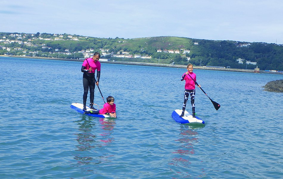Family paddle boarding in Wales