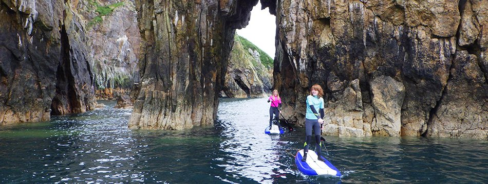Stand up paddle boarding along the North Pembrokeshire coast from Lower Town Harbour to Needle Rock