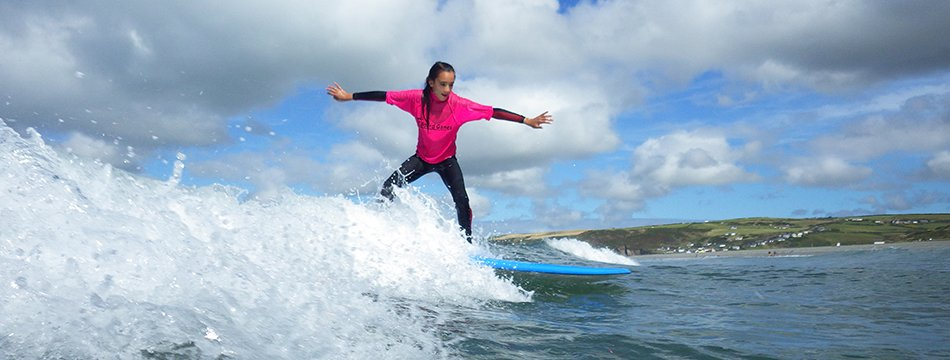 Children having fun while learning to surf at Newgale beach in Pembrokeshire, Wales