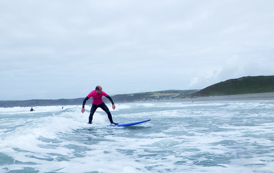 Father learning to surf in Wales