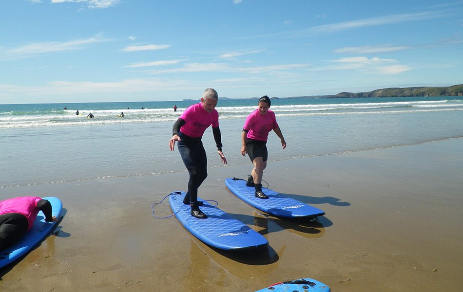 Parents surfing in Pembrokeshire