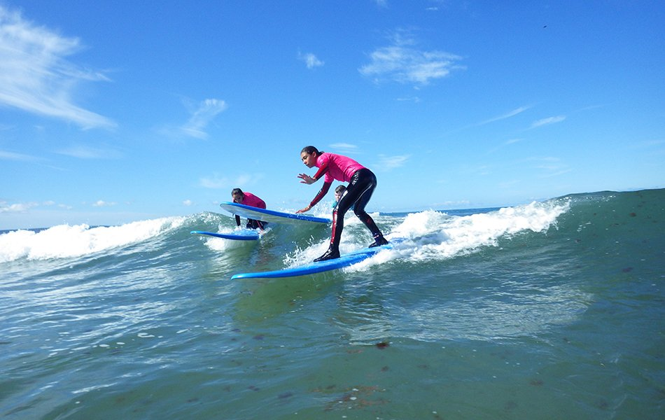 Teens learning to surf
