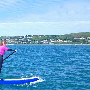 Family exploring the North Pembrokeshire Coast while Stand up Paddleboarding, Wales