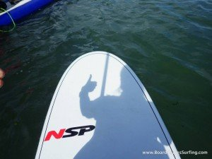 NSP SUP Paddle Board, shadow of the paddlers thumbs up while exploring the Pembrokeshire Coast