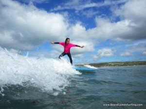 Girls surfing lessons in Pembrokeshire with Board Games Surfing.