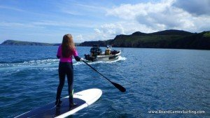 Paddle boarding in Pembrokeshire, chatting with the local fishermen