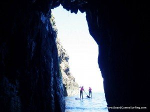 Stand up paddle boarding with Board Games Surfing, exploring sea caves on the Pembrokeshire Coast