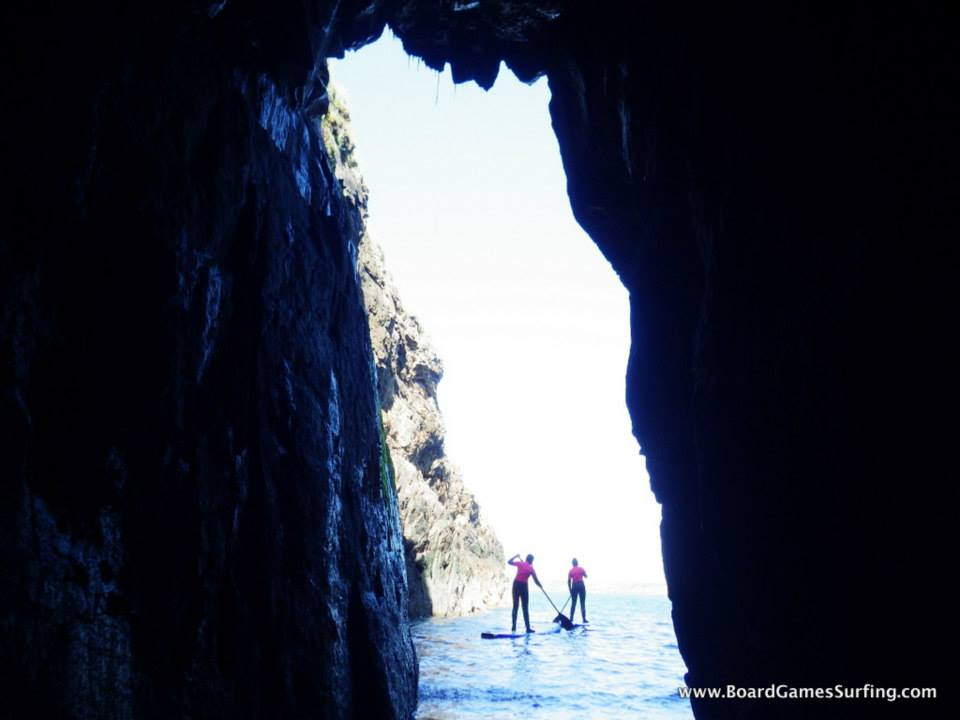 https://www.boardgamessurfing.com/wp-content/uploads/2015/11/paddle-boarding-sea-caves.jpg