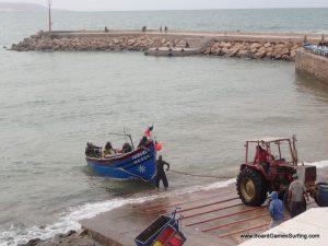 Moroccan fishermen bringing in the fish.